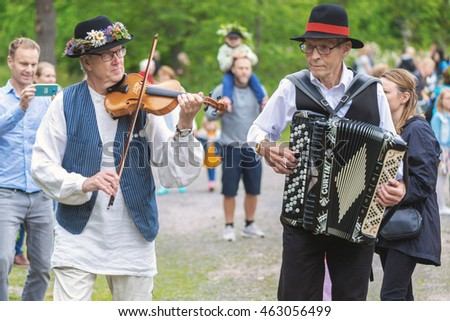 SINGO, SWEDEN - JUNE 24, 2016: Traditional music is played with violin and accordion for people to dance to. Traditional event in Sweden #463056499