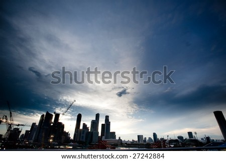 Singpore skyline in dramatic clouds - silhouette
