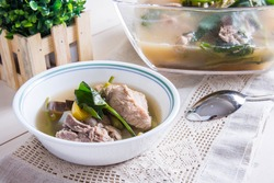 sinigang or tamarind soup with pork and vegetables