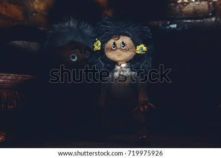 Sinister dolls emerge from the darkness of ancient sewer.Halloween toys.Original photo of ancient toy (copyright free) retouched and colored, neither artworks, layers nor external references were used