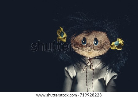 Sinister vintage rag doll with long dark hair and white leather coat. Original photo of ancient toy (copyright free) retouched and colored, neither artworks, layers nor external references were used