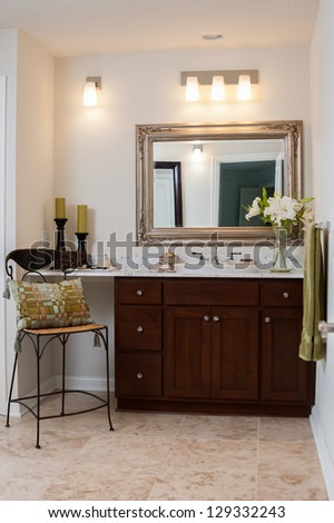 Sink and vanity in master bathroom of an upscale home