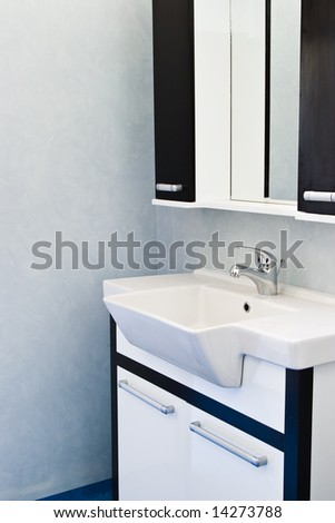 sink in bathroom with furniture