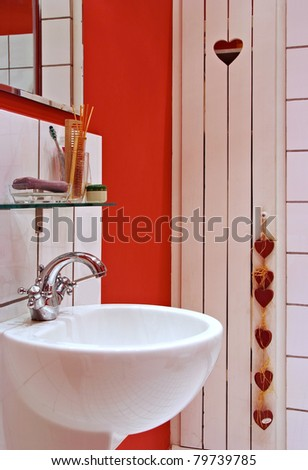sink in Interior of red bath room