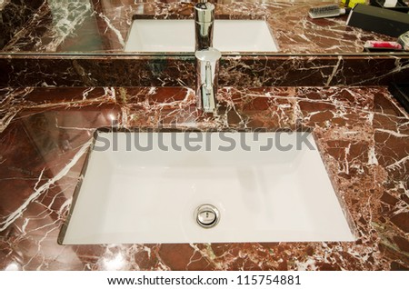Sink in marble stand - stock photo