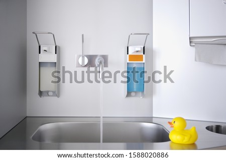 Sink in medical facility with toy rubber duck on counter