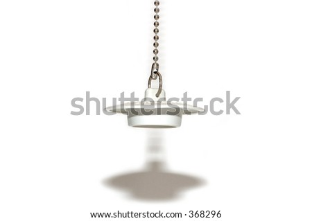 Sink plug with chain over white background. - stock photo