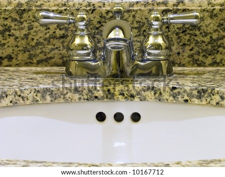 Sink with taps for hot and cold water