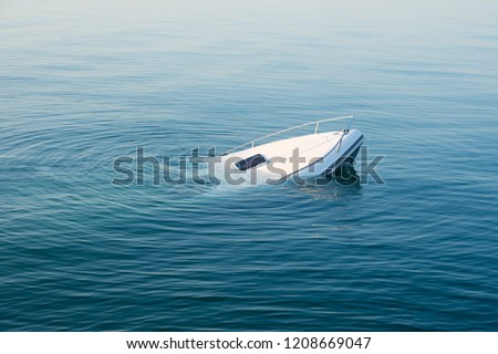 Sinking modern large white boat goes underwater