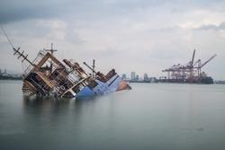 Sinking ship. Industrial sea port of Mersin. Turkey