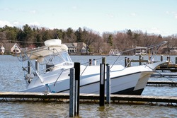 sinking white catamaran boat in marina boat slip
