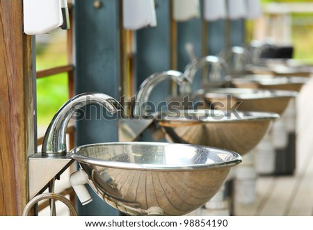 sinks and taps outdoor - stock photo