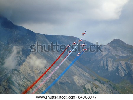 SION, SWITZERLAND - SEPTEMBER 17: Patrouille de France in the mountains at the Breitling Air show.  September 17, 2011 in Sion, Switzerland