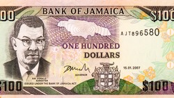 Sir Donald Sangster (1911-1967), a second Prime Minister of Jamaica. Portrait from Jamaica 100 Dollars 2003-2010 Banknotes. An Old paper banknote, vintage retro. Famous ancient Banknotes. Collection.