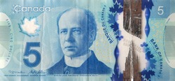 Sir Wilfrid Laurier Portrait from Canada 5 Dollars 2013 Polymer Banknotes fragment close up