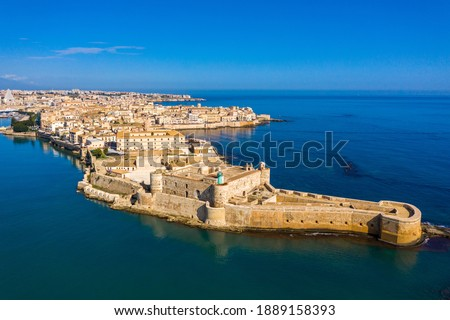 Siracusa, Ortigia Island from the air, Sicily, Italy. Isola di Ortigia, coast of Ortigia island at city of Syracuse, Sicily, Italy. Coastline town Syracuse, Sicily and old Ortigia island. Aerial view.