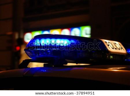 siren on a night patrol car in barcelona, spain