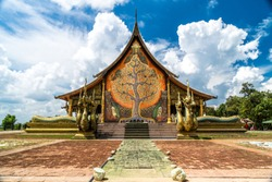 Sirindhorn Wararam or Phu Phrao Temple. The temple is glittering at night and is located in Ubon Ratchathani, Thailand.