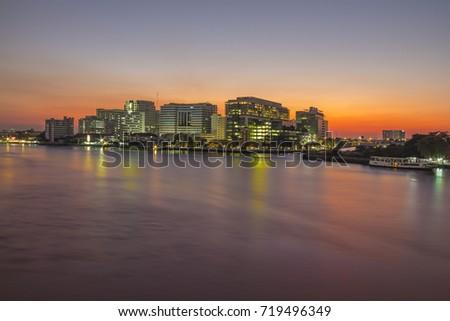 Siriraj Hospital at Bangkok,Thailand. / Siriraj Hospital - The building along the Chao Phraya River,in the evening light.