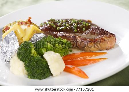 sirloin, sirloin steak with brown pepper sauce and baked potato