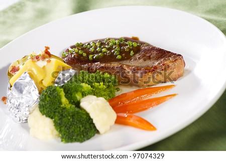sirloin steak, sirloin steak with brown pepper sauce and baked potato