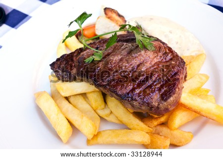 Sirloin strip Steak -entrecote- with vegetables and savory bechamel-sauce