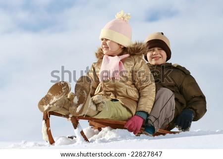 stock photo sister and brother on sledge winter friendship 22827847 stock photo : sister and brother on sledge, winter friendship