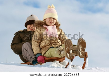 stock photo sister and brother on sledge winter friendship 23726665 stock photo : sister and brother on sledge, winter friendship