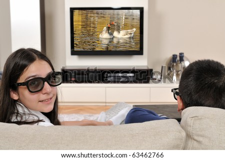 Sister and brother watching 3d film on TV - a series of WATCHING TV images.