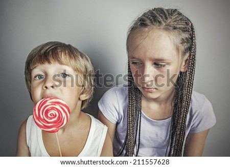 sister jealous brother who eats candy Stockfoto ©