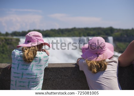 Sister Twins with Pink Sun Hats viewing the Niagara Falls landscape and water falls