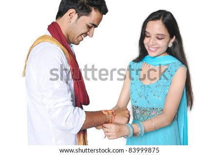 Sister tying Rakhi on her brother's wrist on the occasion of Rakshabandhan