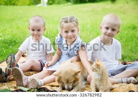 Sister with brothers with a cat and a dog in the park