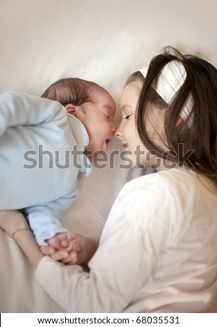 Sister with her newborn baby boy brother