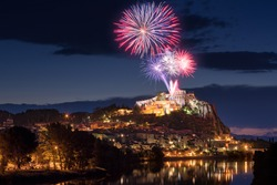 Sisteron with 14th of July fireworks (Bastille Day celebration) over the Citadel at twilight. Durance Valley, Provence, Alpes-de-Haute-Provence, France
