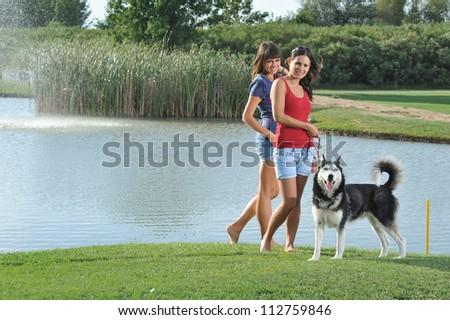 sisters and her faithful husky