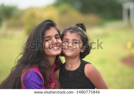 Sisters best friends play. Sweet childhood. Childhood concept. Softness and tenderness.  Love and friendship.  Happy childhood.