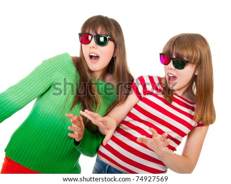 Sisters having fun while watching 3D movie isolated on white background