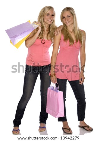 sisters holding shopping bags on white isolated background