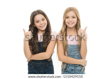 Sisters kids isolated white background. Sisterly relationship. Sisterhood happiness. Girls confident sisters. Sisterhood support or competition. Siblings relations. Well done. Sisterhood goals.