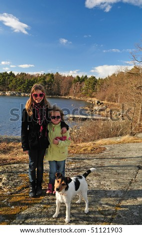 stock-photo-sisters-with-dog-in-outdoor-portrait-51121903.jpg