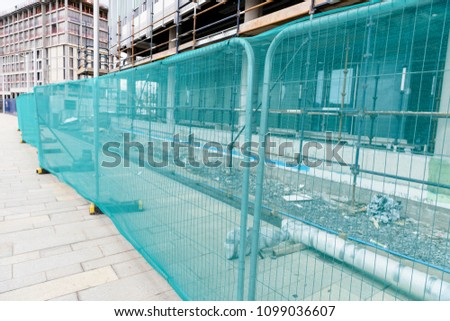 Site fencing around a building site.
