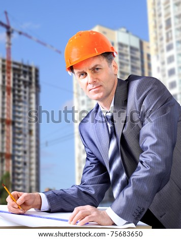 Site manager in the office with helmet - stock photo