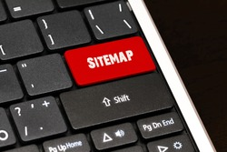 Sitemap on Red Enter Button on black keyboard.