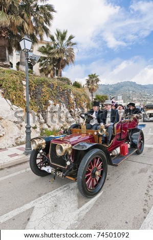 "SITGES, SPAIN - MARCH 27: Cesar Alentorn drives a 1907 Panhard Levassor to Sitges Port for the second phase of the ""53rd Rally of Ancient Cars Barcelona-Sitges"" on March 27, 2011 in Sitges, Spain."