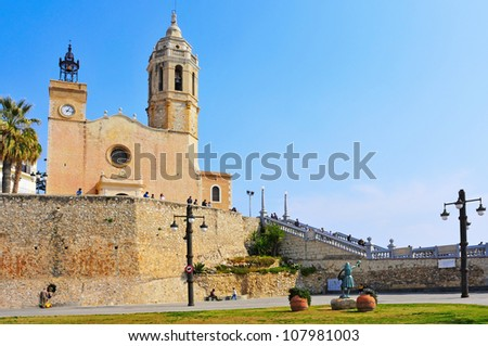 SITGES, SPAIN - MARCH 3: Church of Sant Bartomeu i Santa Tecla on March 3, 2012 in Sitges, Spain. The 17th century church next to the sea is an iconic building of the gay-friendly city