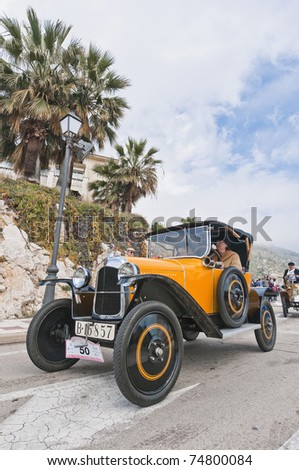 """SITGES, SPAIN - MARCH 27: Cristina Vidal drives a 1924 Citroen 5CV to Sitges Port for the second phase of the """"53rd Rally of Ancient Cars Barcelona-Sitges"""" on March 27, 2011 in Sitges, Spain."""