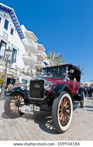 "SITGES, SPAIN - MARCH 11: Jordi Buil drives a 1924 Ford T on the second phase of the ""54th Rally of Ancient Cars Barcelona-Sitges"" on March 11, 2012 in Sitges, Spain."