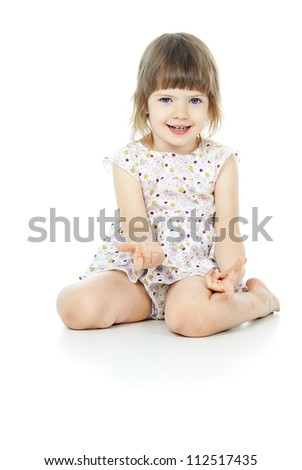 sits a beautiful little girl