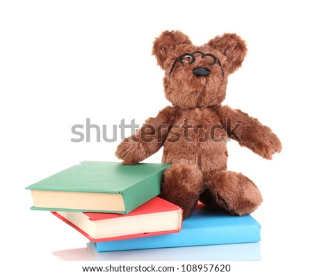 Sitting bear toy with books isolated on white